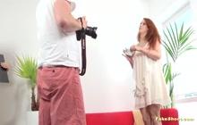 Slutty redhead gets cum on face on fake casting