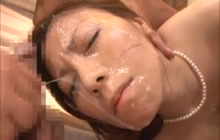 Asian bimbo getting sprayed with a ton of cum